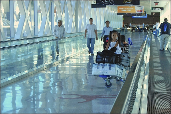 Airline Passengers Leaving Logan Airport In Boston