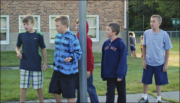 Boys Gathering On Playground First Day of School