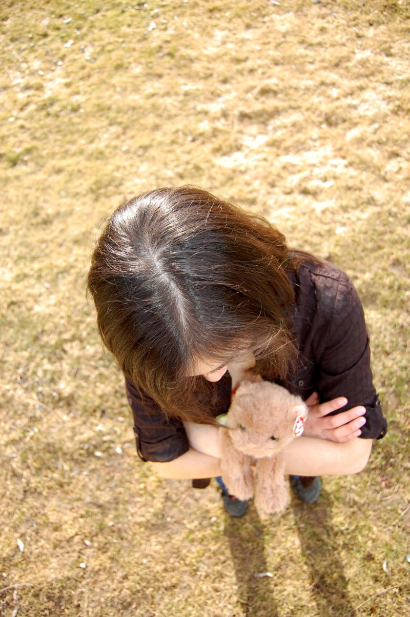 a girl holding a stuffed cat