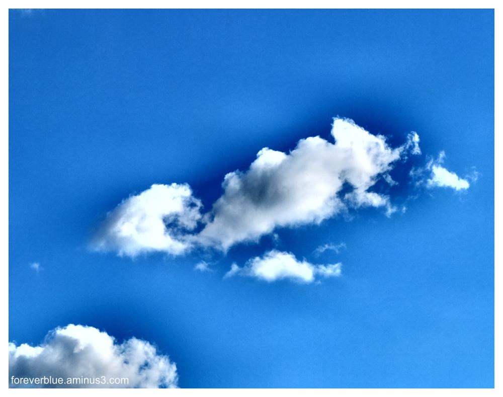 ...ISLANDS CRUISING IN THE DEEP BLUE SKY ...