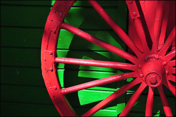 Red wagon wheel on green background