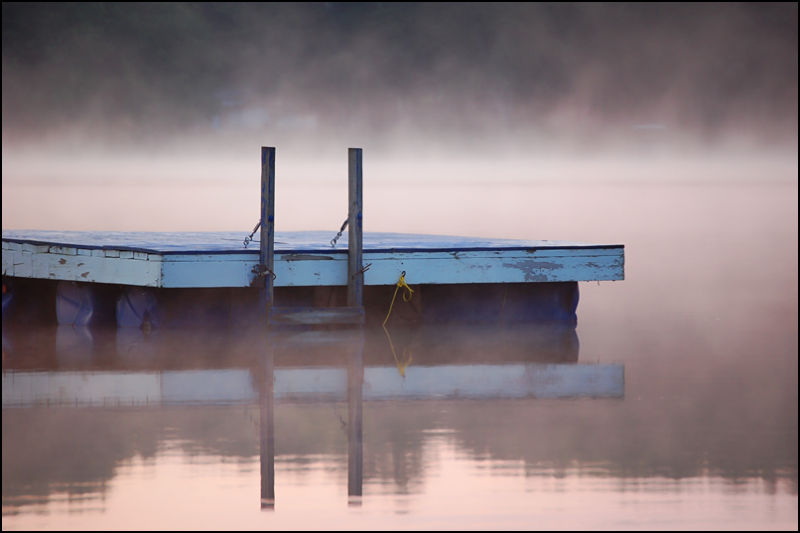 Float on misty morning lake