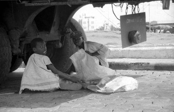 Sous un poids et Soleil lourds (Bénin)