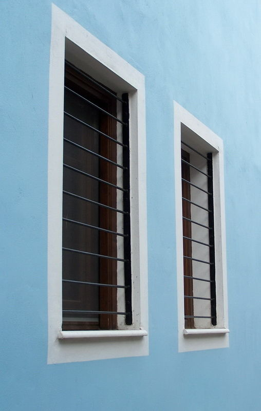 The blue wall and the two windows
