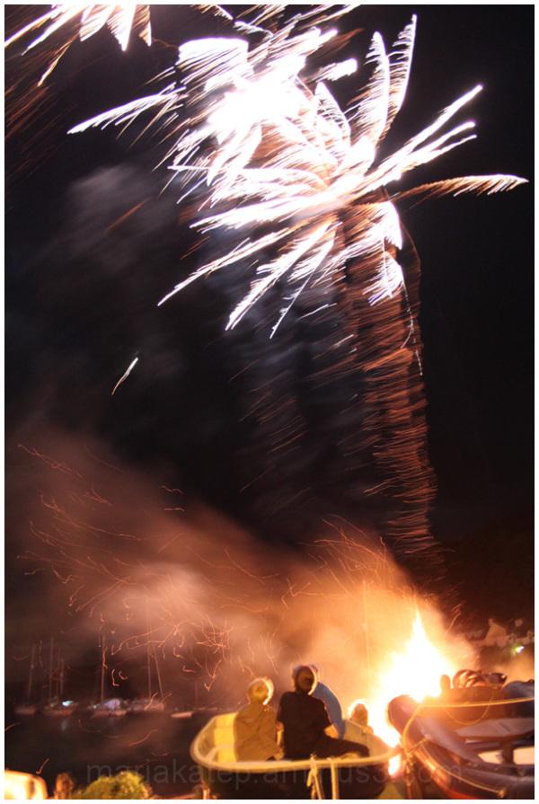 fireworks boys in boat