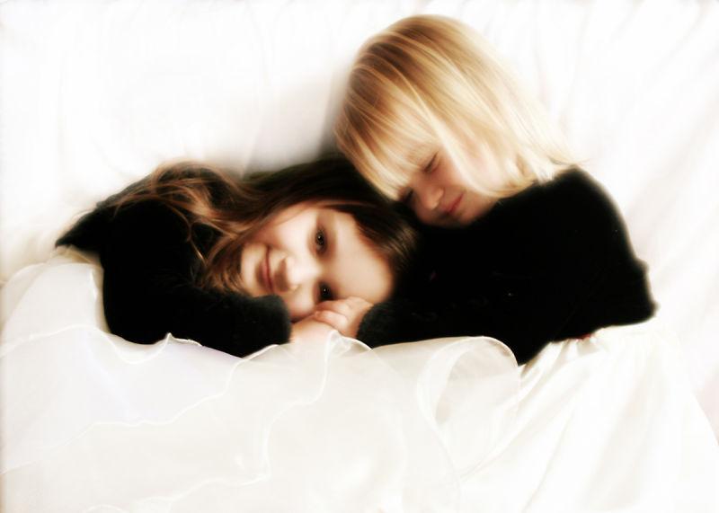 Cuddling Siblings