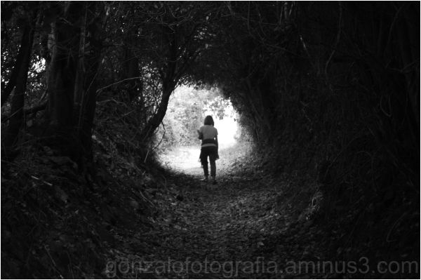 Woman at the end of the tunnel