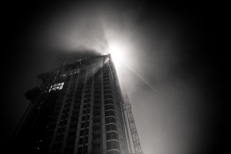 city construction on foggy night