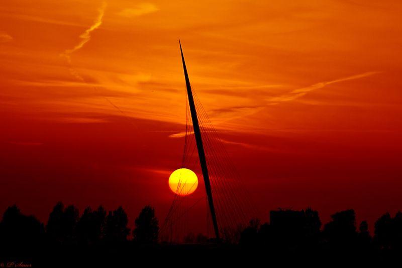 Sun setting over a bridge