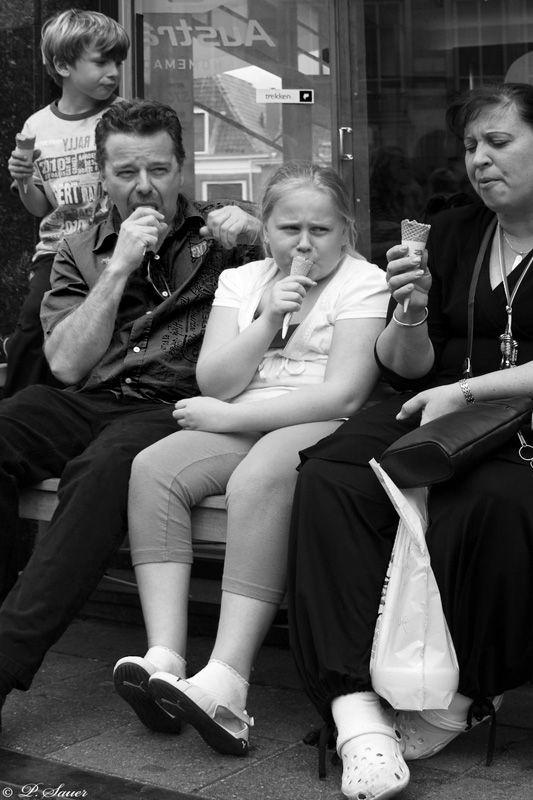 Family enjoying ice cream cones