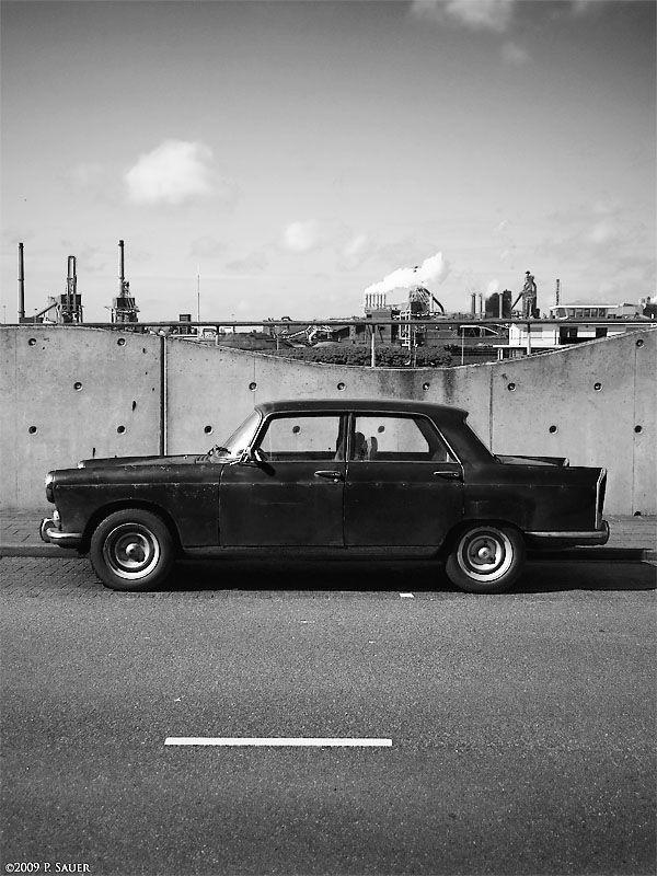Peugeot in front of steel mills