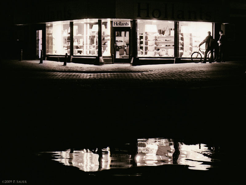 Shoe shop window at night