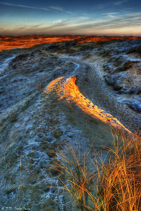 Frozen track through the dunes at dusk