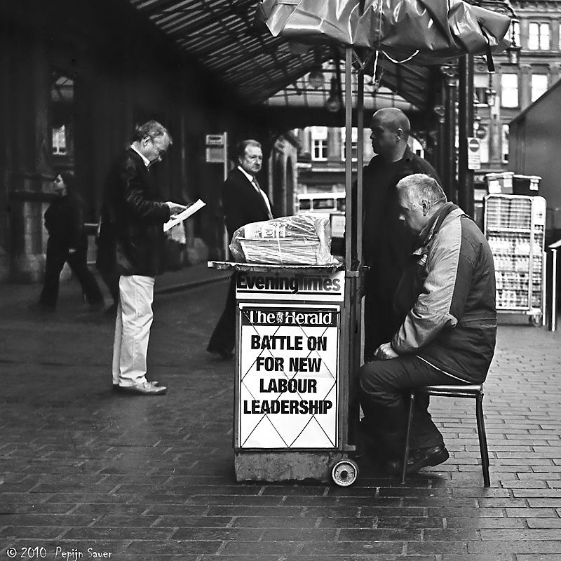Paper seller in front of Glasgow Central Station