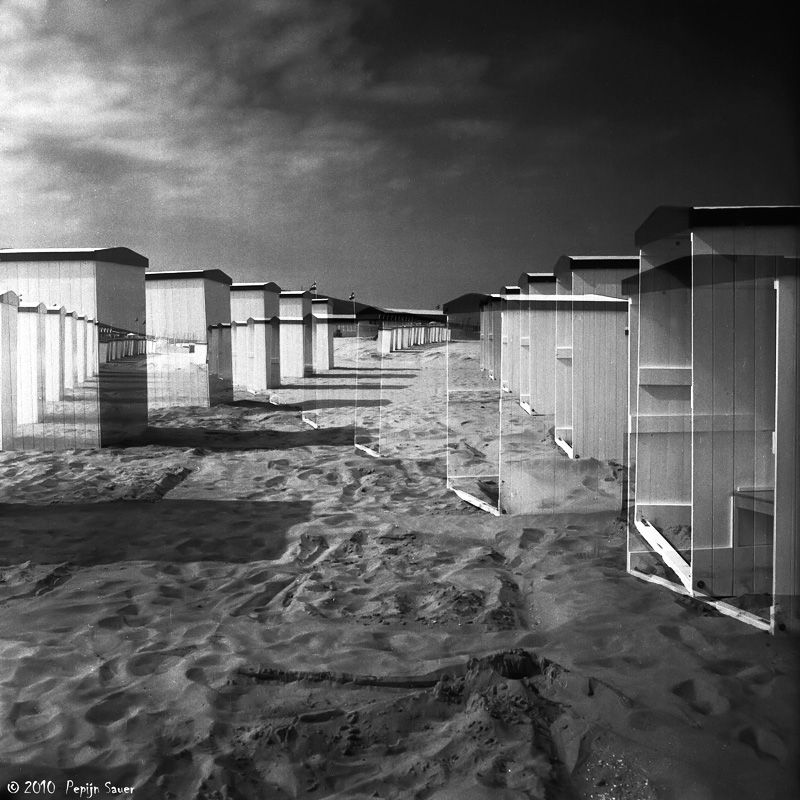Double exposure of beach cabins