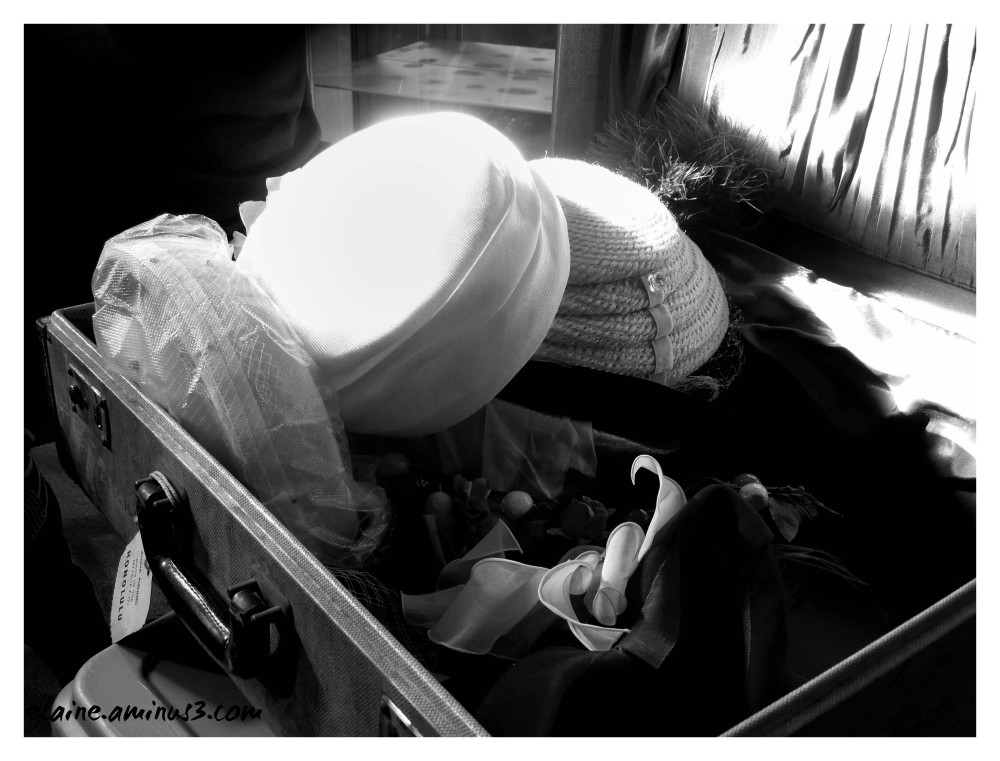 hats in a suitcase