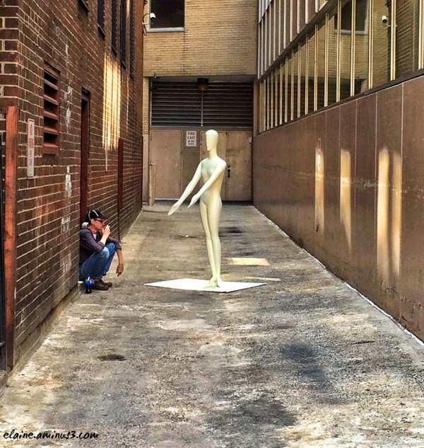 mannequin in an alley