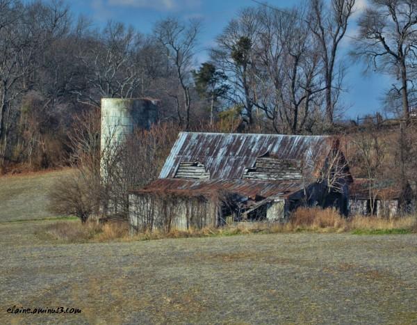 decaying barn and silo