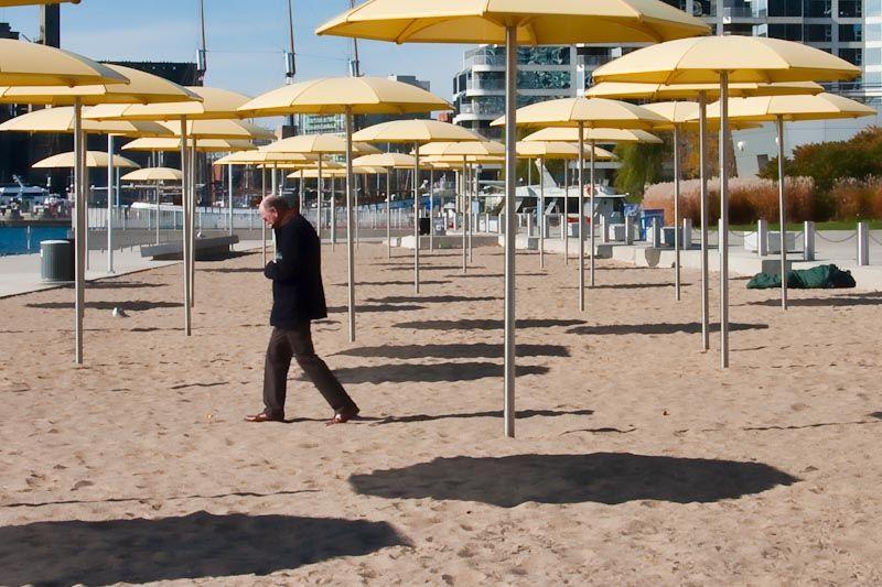 yellow umbrellas cold deserted beach