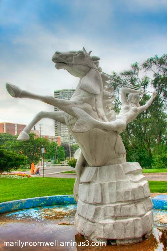 Sculpture statue of mermaid on horse