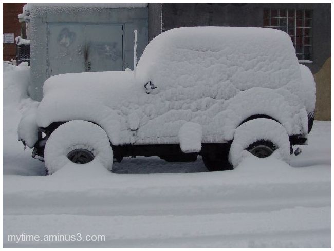 Snow covered Jeep