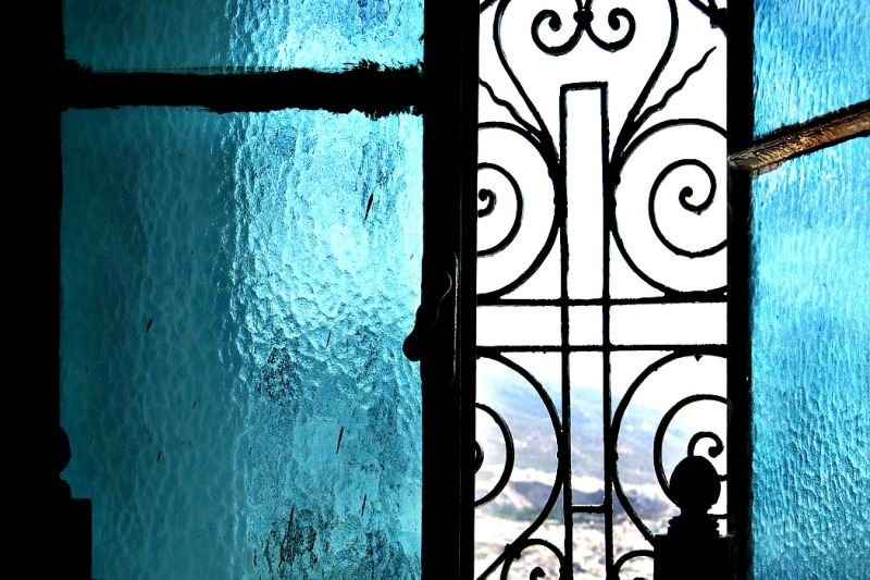 Behind a blue glass
