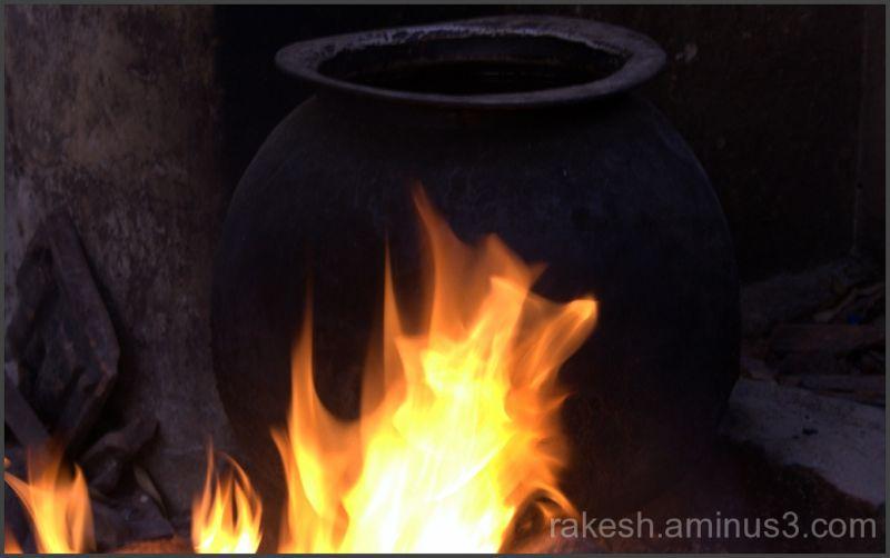 Tribals heating water