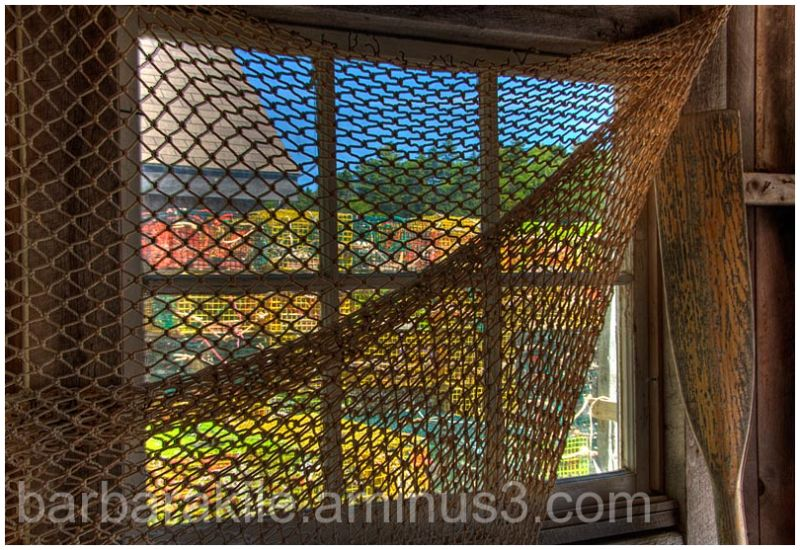 Inside a boat house looking out at lobster cages
