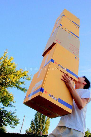 Boy juggling boxes