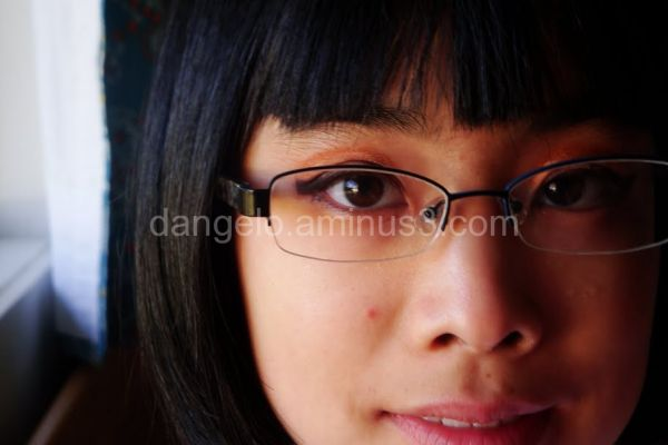 portrait of girl with glasseswearing chalk make up
