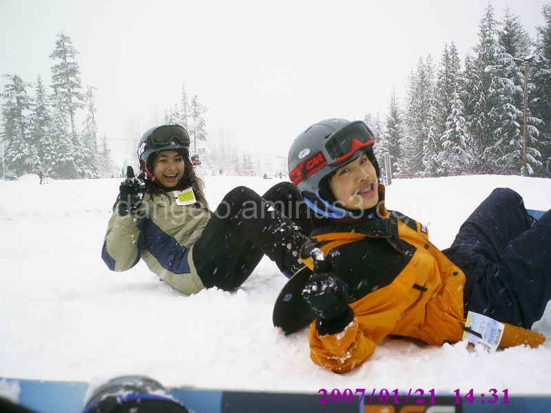 two friends learning to snowboard in Blackcomb