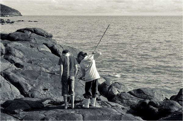 Children, playing, rocks, sea, NZ