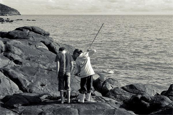 Kids, rocks, beach, playing