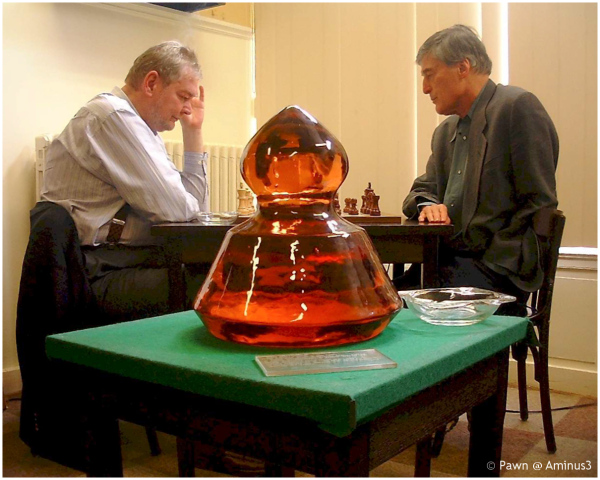 Donnerpawn in front of two chess masters
