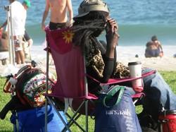 People Beach Brushing Homeless