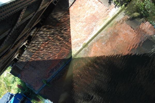realligned water reflection on bridge