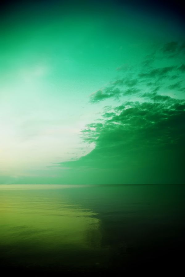 green sky by the sea coast
