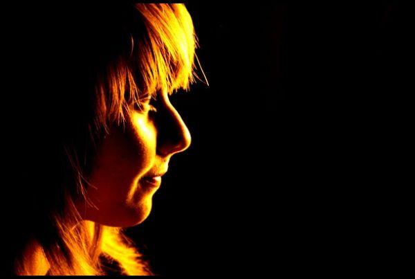 Girl under streetlight, France