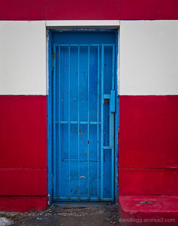 Blue Door in Red Wall