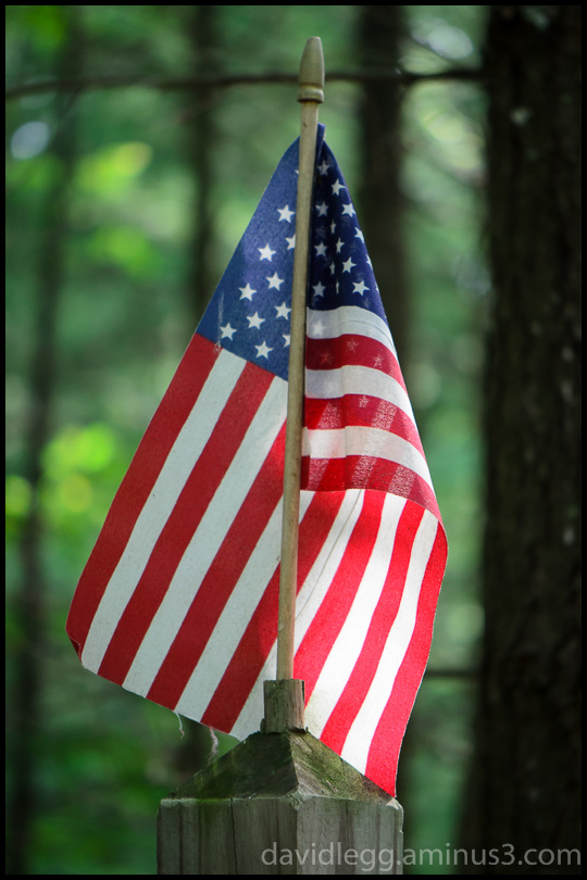Old Glory on a Fence Post