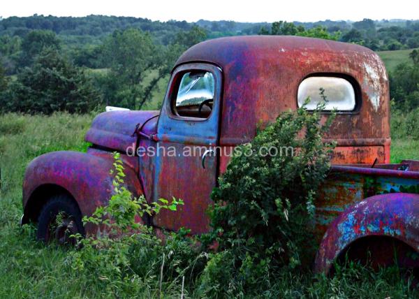 rusty 1941 International truck in a field