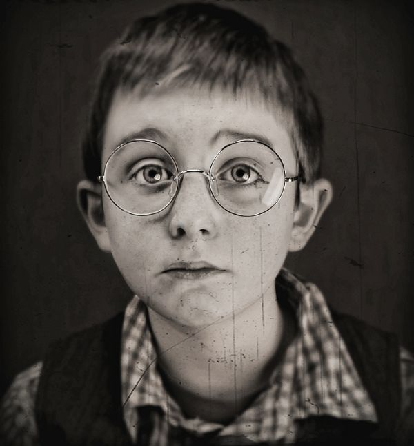 the boy with the glasses