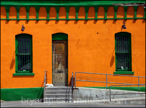 Colorful building front in orange & green