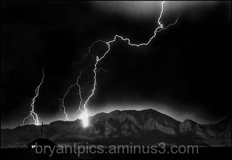 Lightning striking mountain at night