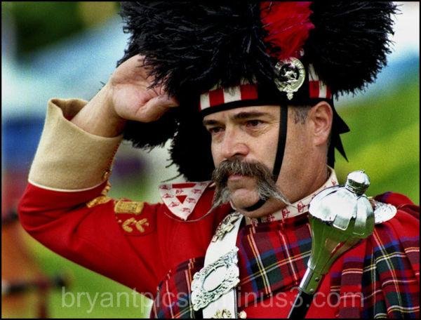 Drum-Major of pipe & drum band salutes
