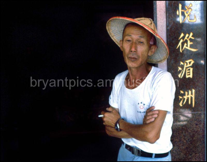 Chinese man in temple doorway
