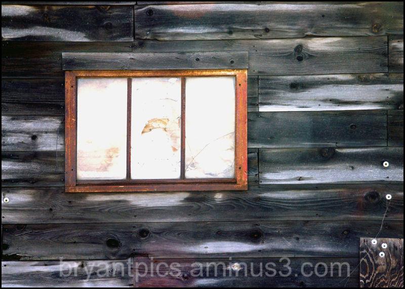 old window in boarded building