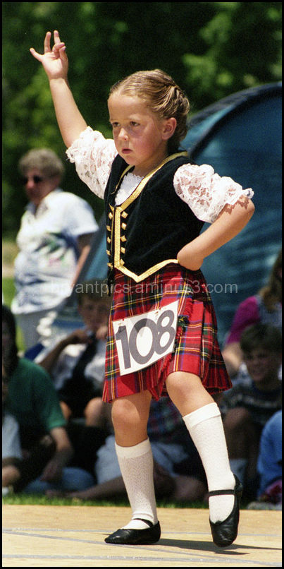 Little girl performs highland dance