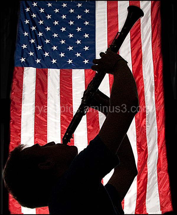 Jazz musician in front of flag