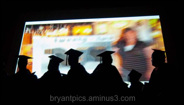 Graduation students watch video
